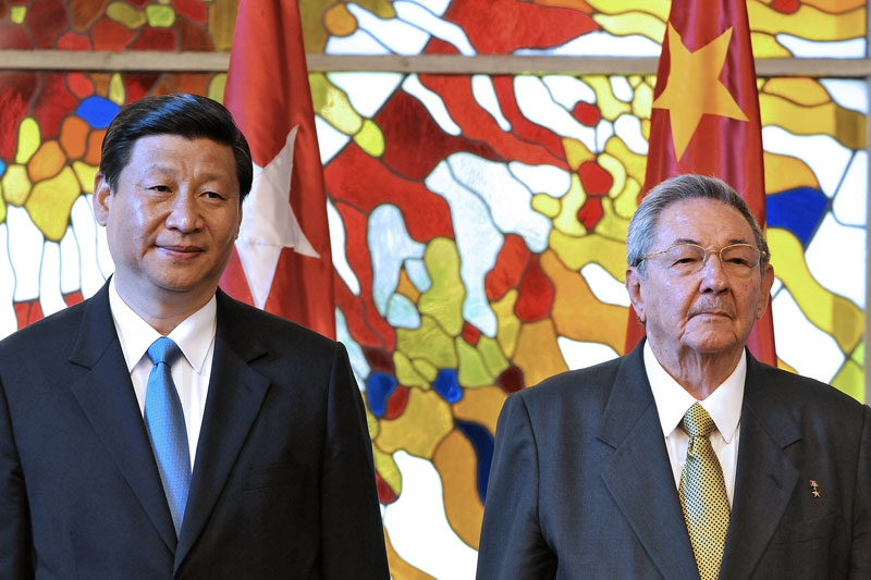 China's Vice-President Xi Jinping (L) is seen alongside Cuban President Raul Castro (R), on June 5, 2011 at Revolution Palace in Havana. China has investments in transportation, oil, appliances, communications and tourism in Cuba. (Alejandro Ernesto/AFP/Getty Images)