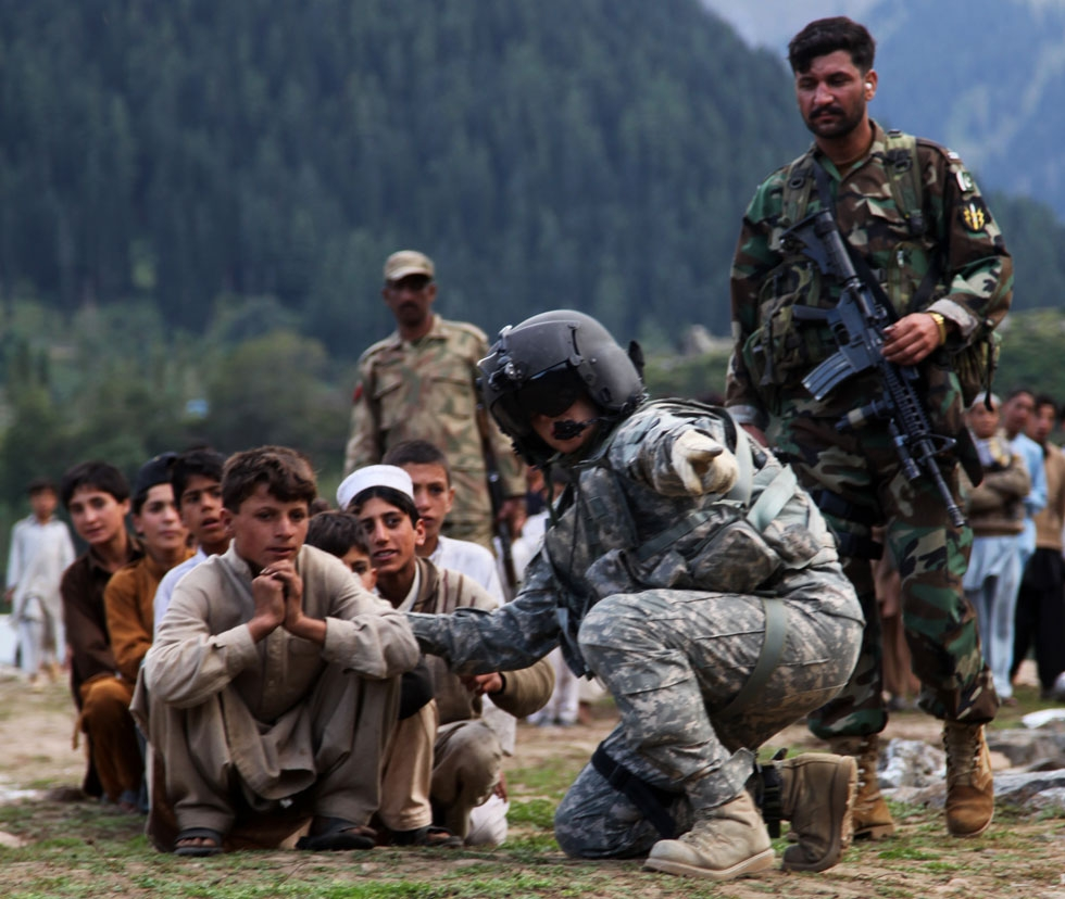 Local Pakistani kids await to be evacuated on a CH-60 Blackhawk in Khyber - Pakhtunkhwa, Pakistan, on Sept. 13, 2010. Photo By Joshua Kruger. (Flickr/DVIDSHUB)
