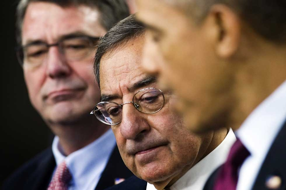 "U.S. Defense Secretary Leon Panetta (C) listens as U.S. President Barack Obama (R) delivers remarks on the Defense Strategic Review at the Pentagon in Washington, D.C. Also pictured is Deputy Secretary of Defense Ashton Carter (L). President Obama vowed Thursday that the U.S. military would maintain its ""superiority"" and bolster its presence in Asia despite planned cuts to the defense budget. (Jim Watson/AFP/Getty Images)"