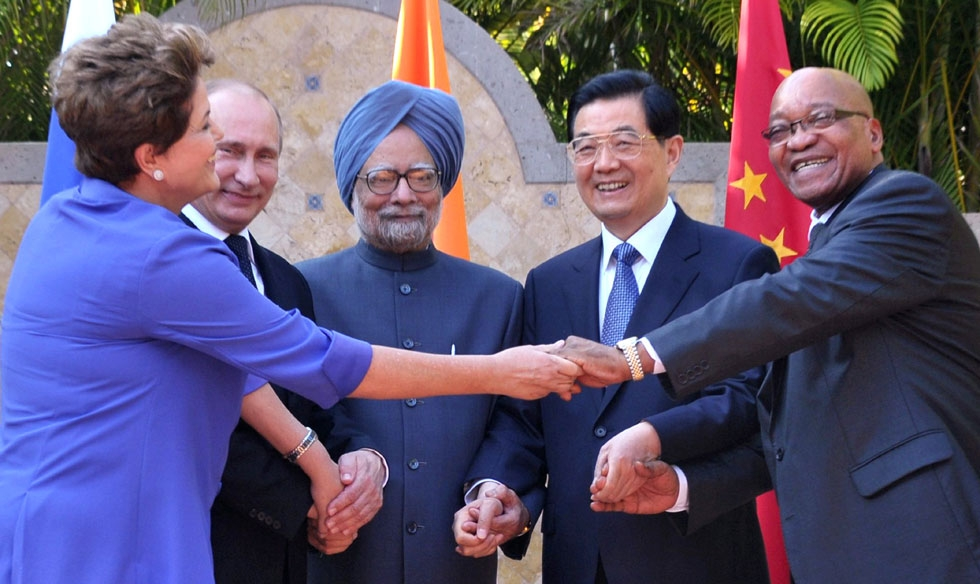 (L to R) Brazilian President Dilma Roussef, Russian President Vladimir Putin, Indian Prime Minister Manmohan Singh, Chinese President Hu Jintao and South African President Jacob Zuma join their hands during a BRICS's Presidents meeting in Los Cabos, Baja California, Mexico on June 18, 2012 before the opening of the G20 leaders Summit. (Roberto Stuckert Filho/AFP/Getty Images)