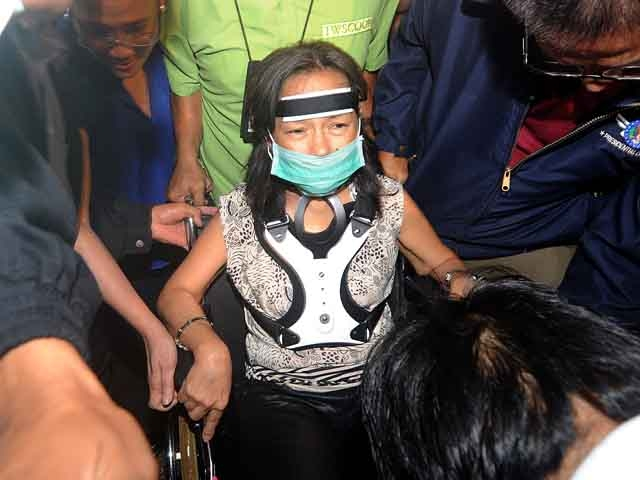 Former Philippines President and congresswoman Gloria Arroyo (C) arrives at the Manila International Airport in Manila on Nov. 15, 2011. (Noel Celis/AFP/Getty Images)