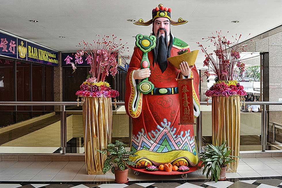 A figurine of the God of Wealth display at the Fu Lu Shou Complex in Singapore on January 29, 2013. (chooyutshing/flickr)