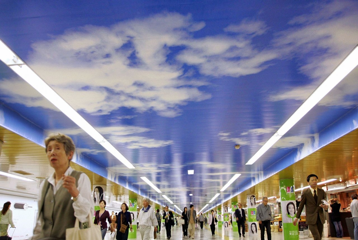Commuters walk along an underground concourse decorated with a blue-sky ceiling at Metro's Shinjuku Station in Tokyo. (Kazuhiro Nogi/AFP/Getty Images)