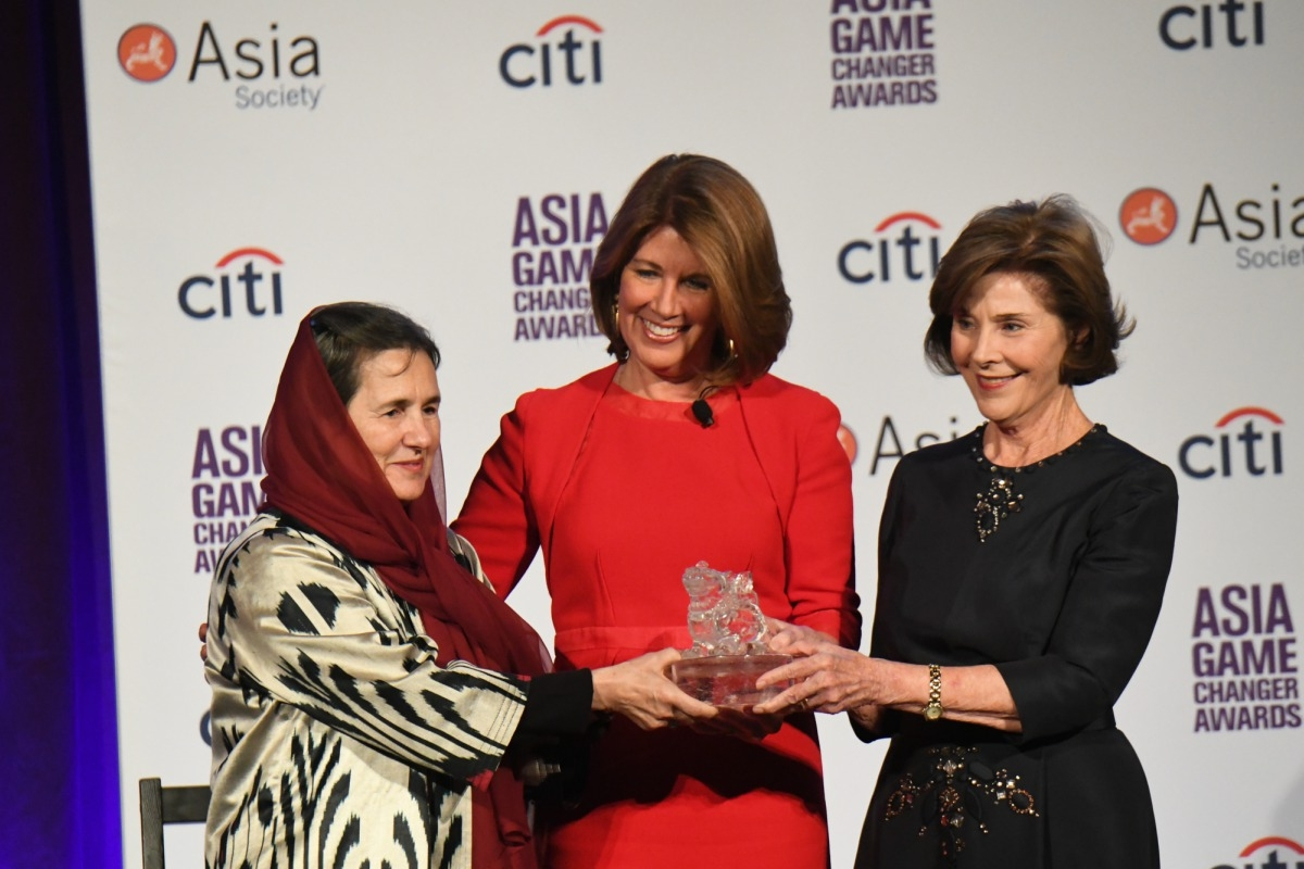 Rula Ghani, Sherrie Westin, and Laura Bush speak at the Asia Game Changer Awards.