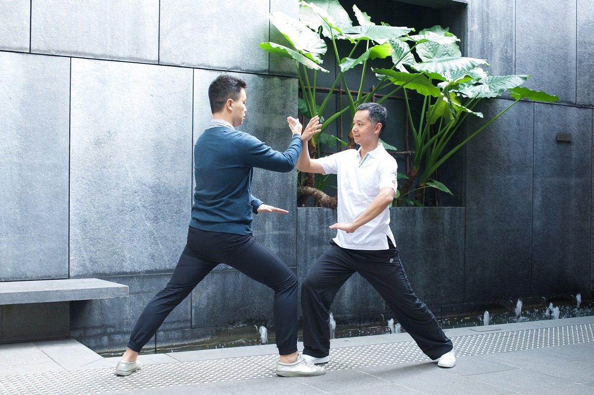 Master Bernard Kwan demonstrates with a member