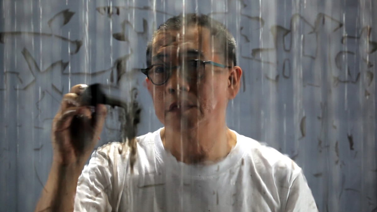 FX Harsono. (Still) Writing in the Rain, 2011.
