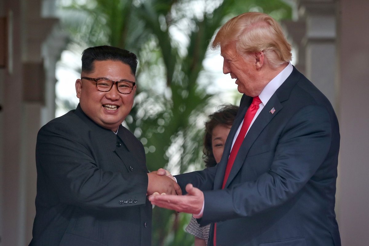 Kim Jong Un and President Trump congratulate each other following Tuesday's summit in Singapore.