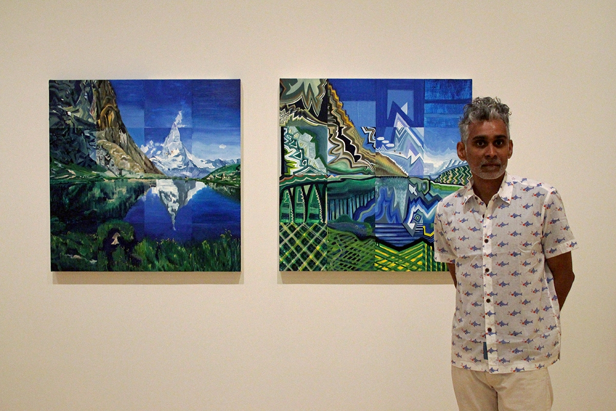 Kanishka Raja poses in front of I and I (Missed Twice); SW1-XY at Asia Society New York, 2017