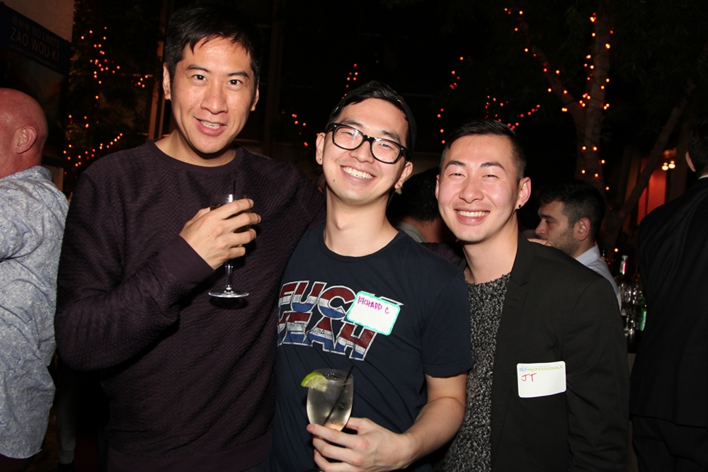Friends smile for the camera at Asia Society's LGBT Connections Night.