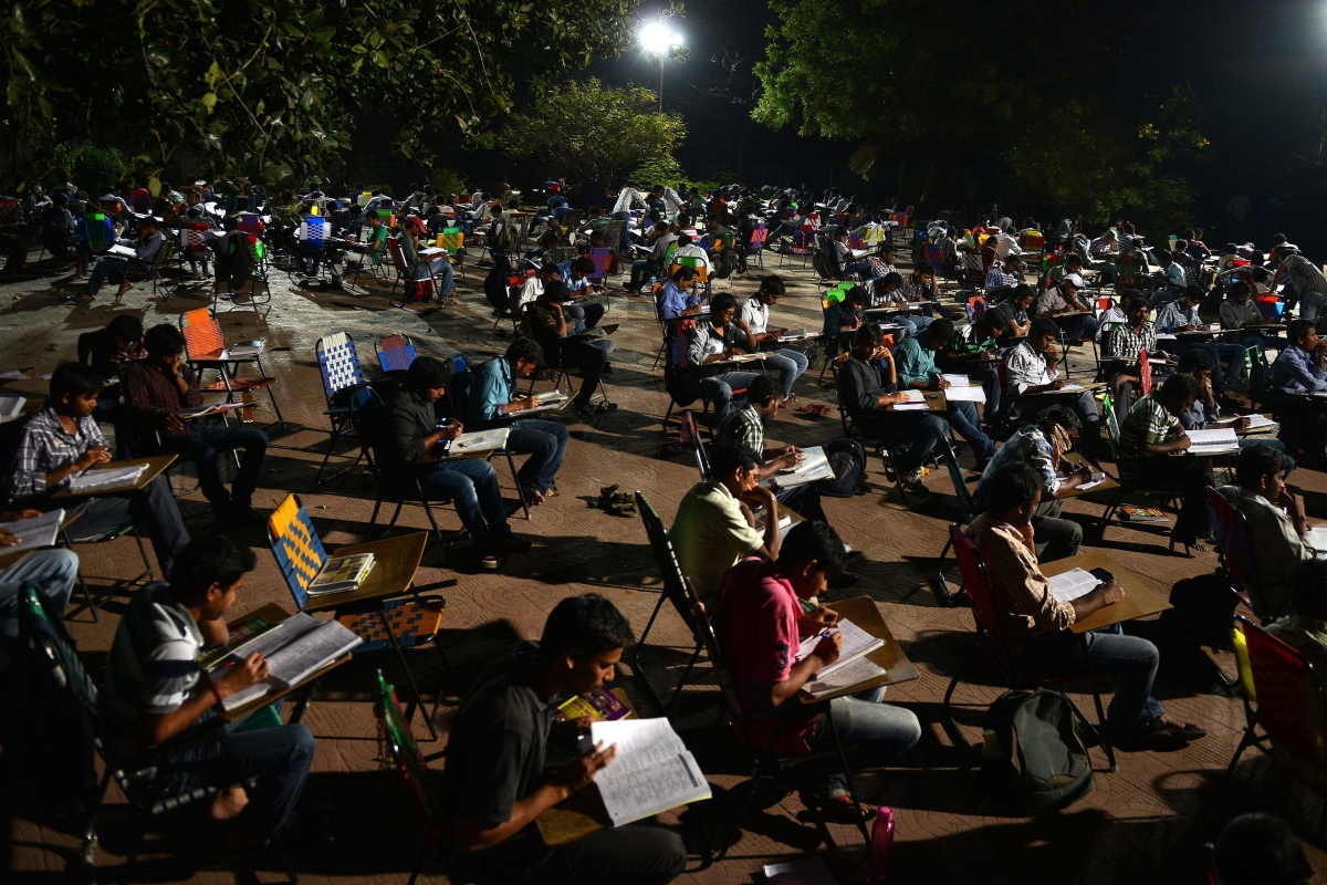 Students study for competitive exams in an open space of the City Central Library in Hyderabad.
