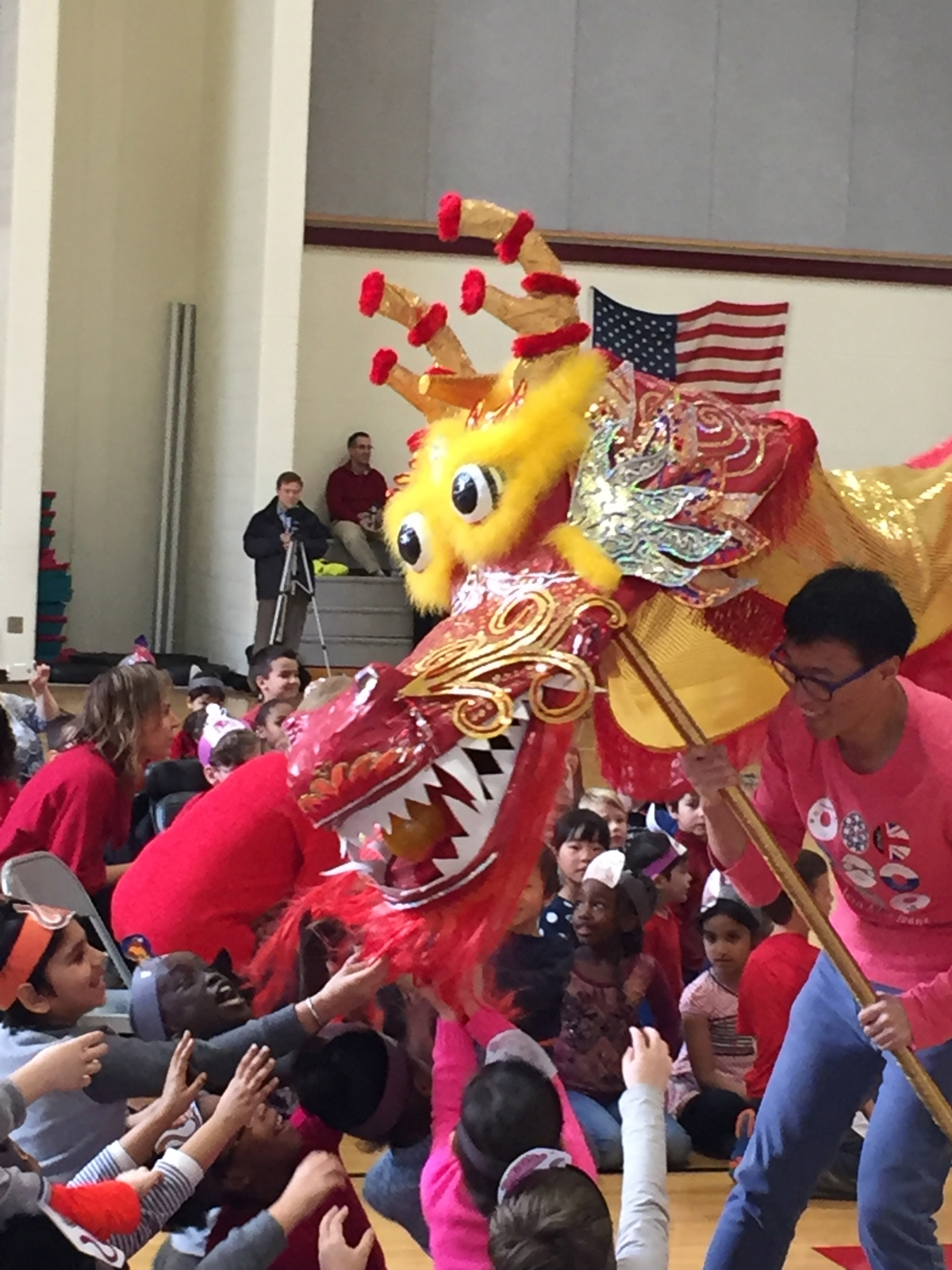 Forest Hills Public Schools elementary students experience a dragon dance while celebrating the Chinese New Year.