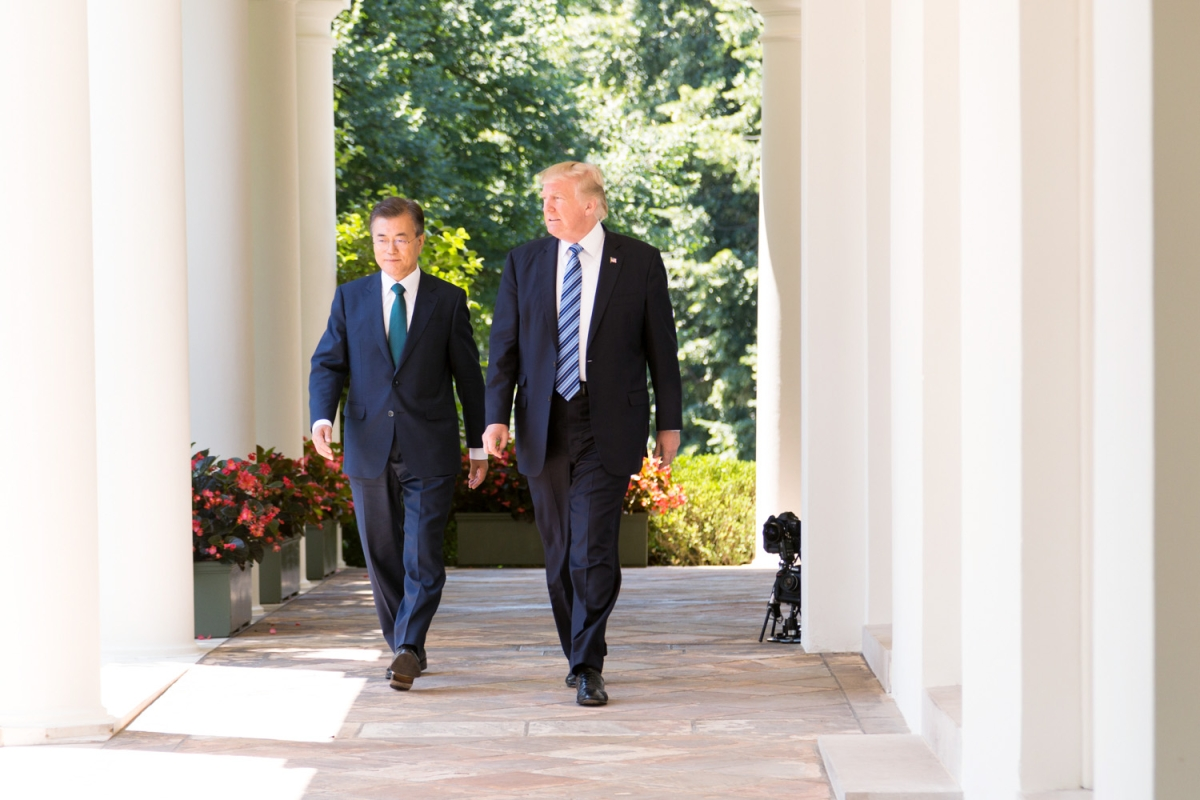Presidents Moon Jae-in and Donald Trump walk together at the White House in June 2017
