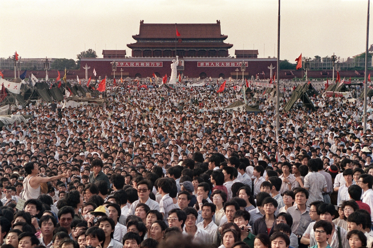 Thousands of people pour into Beijing's Tiananmen Square in the weeks before the June 4, 1989 massacre.