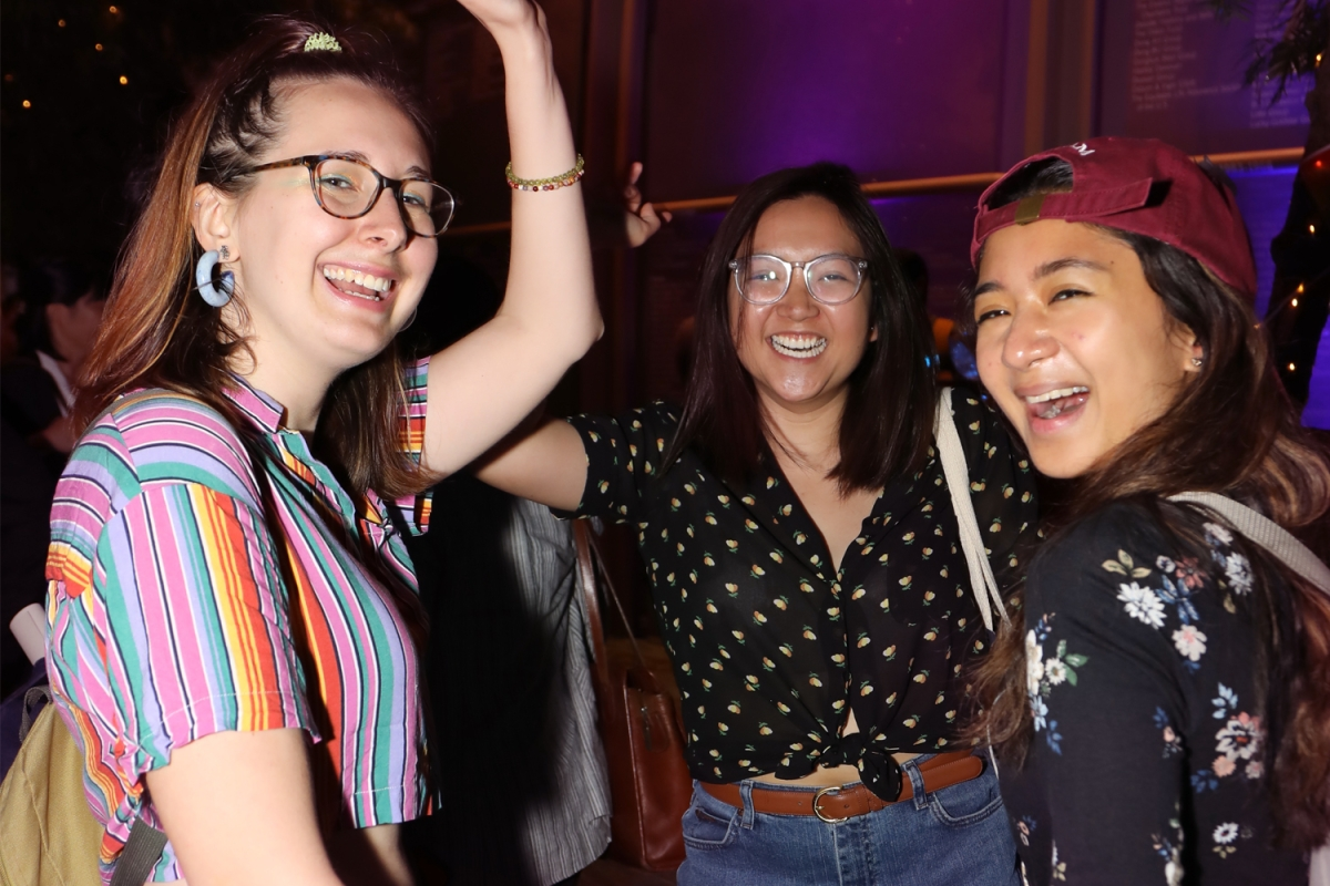 Friends show off their moves at a Friday Leo Bar. (Ellen Wallop/Asia Society)