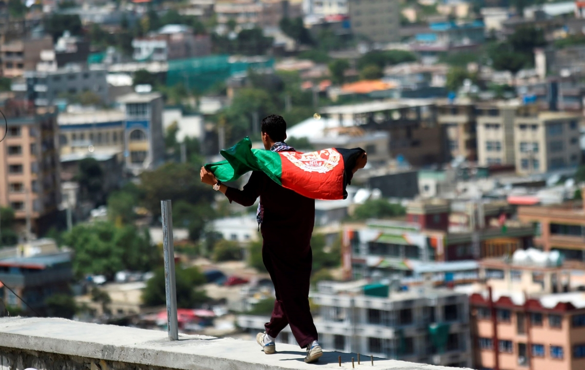 Man with flag celebrating Afghanistan's 100th anniversary of its independence