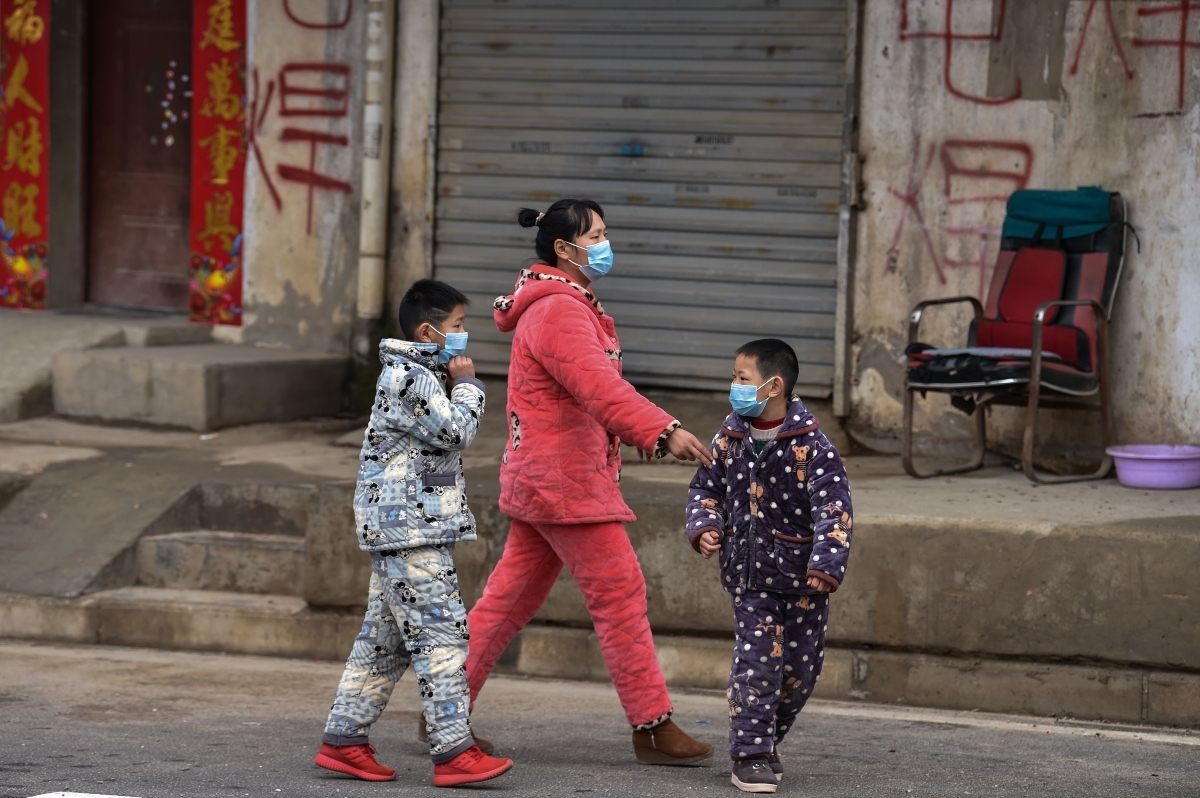 Residents of Wuhan, China wear protective masks to guard against the coronavirus.