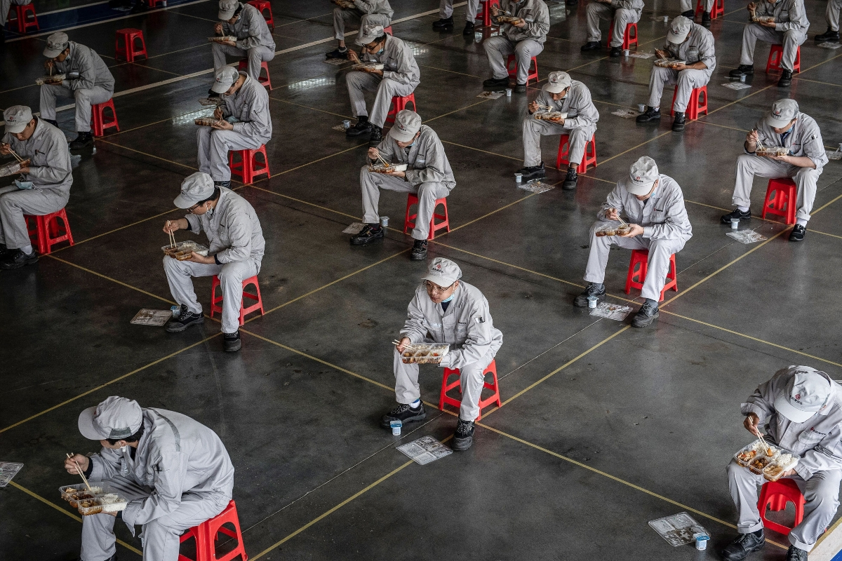 Factory workers in Wuhan, China, return to work