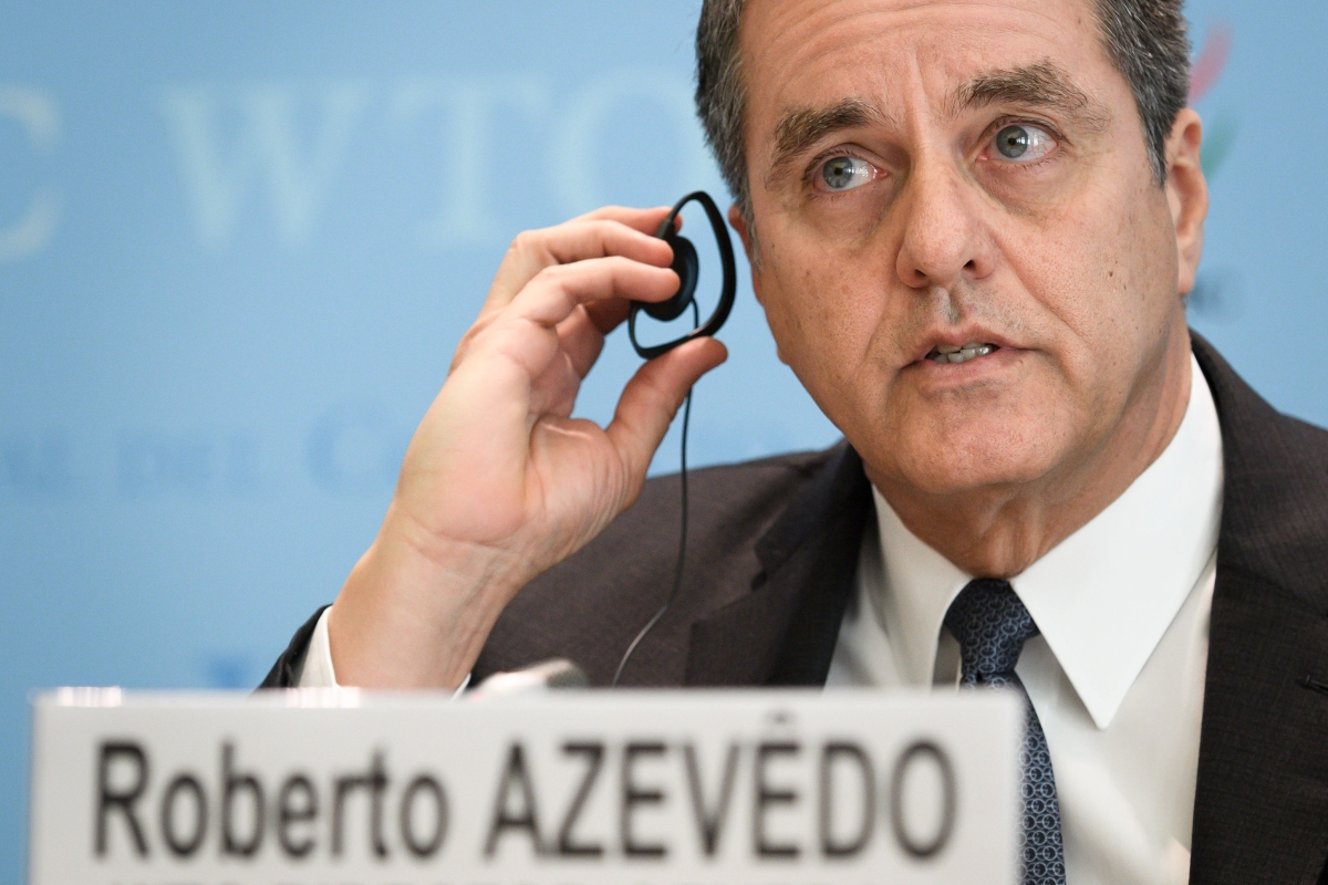 WTO DG Roberto Azevedo holds an earpiece