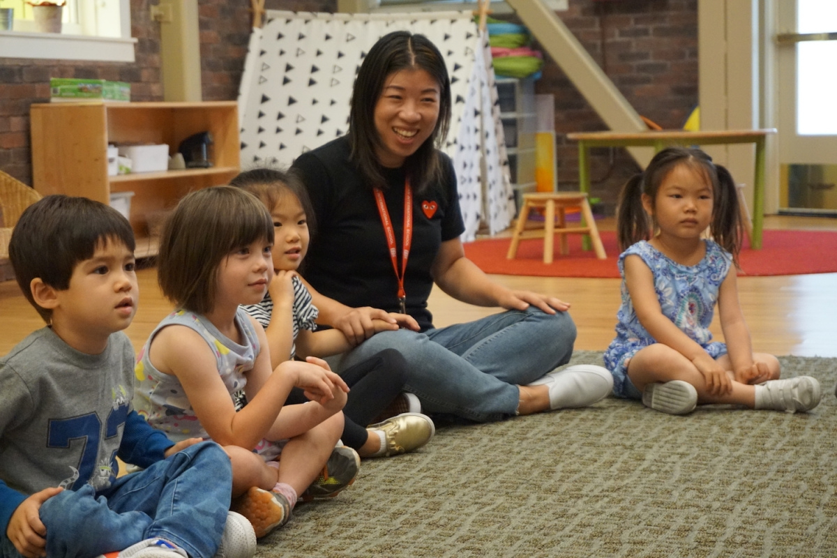 Students enjoying a song during Music and Movement class