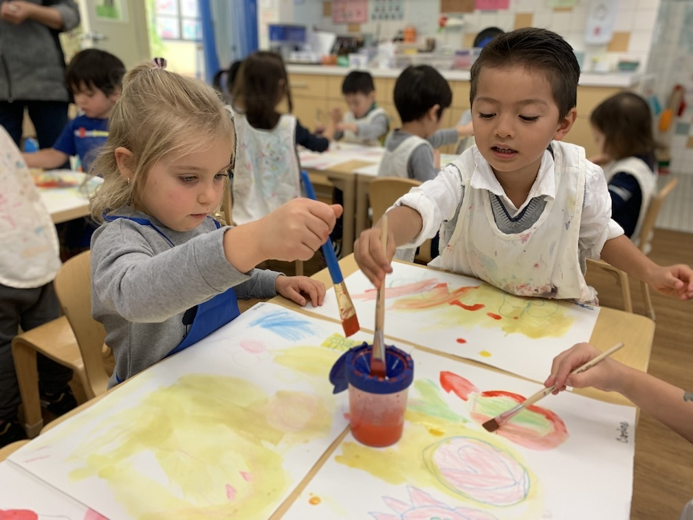Students painting during art class