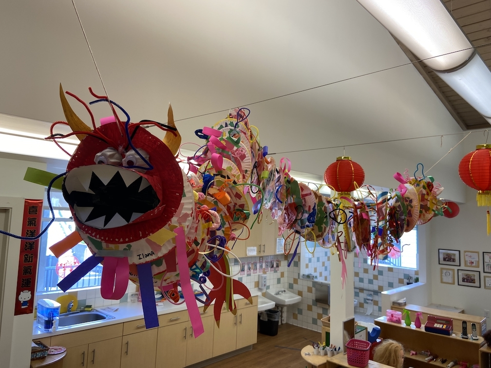 Chinese New Year dragon made by Pre-K students on display in the classroom