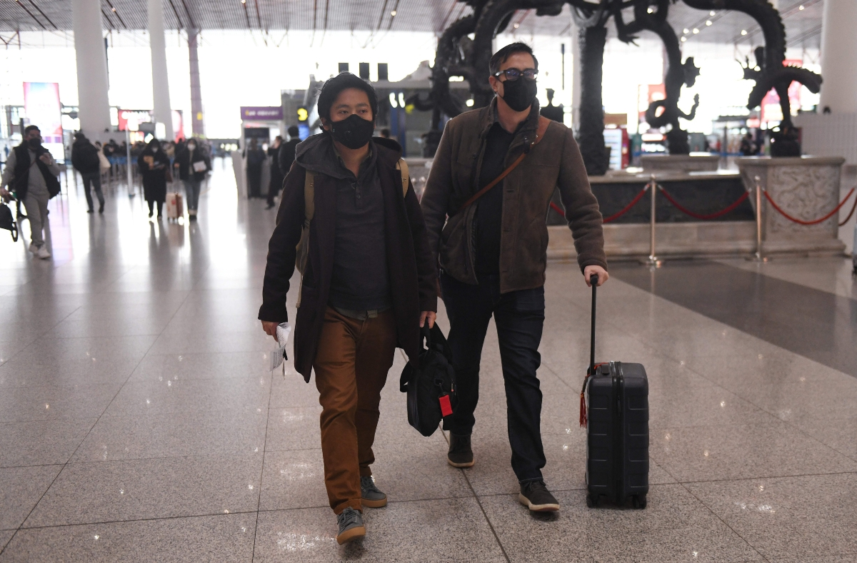 Wall Street Journal reporters Philip Wen (L) and Josh Chin (R) departing China in February