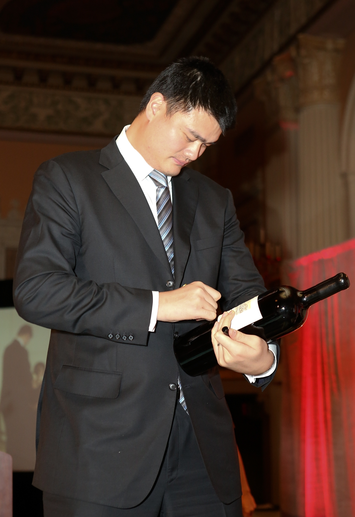 "Yao Ming, honored as ""Visionary of the Year"" autographs a bottle of his Yao Family Wine during the Asia Society Southern California 2013 Annual Gala held at the Millennium Biltmore Hotel on Tuesday, February 19, 2013 in Los Angeles, Calif. (Photo by Ryan Miller/Capture Imaging)"