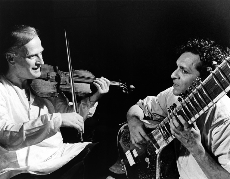 One of Shankar's first engagements with Western music was his collaboration with violinist Yehudi Menuhin (L). The two are shown here rehearsing together in 1966. (David Farrell/Redferns)