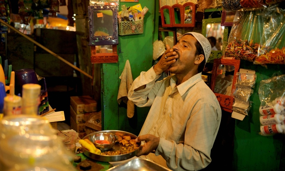 Indian Muslim vendors break their fast during Ramadan in a market area of Allahabad in 2009.  (Diptendu Dutta/AFP/Getty Images)