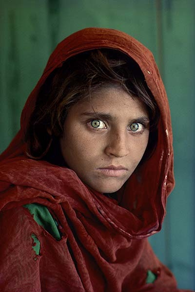 "Steve McCurry. Sharbat Gula, ""Afghan Girl,"" at Nasir Bagh refugee camp near Peshawar, Pakistan, 1984. © Steve McCurry."