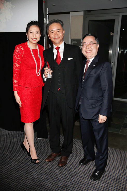 From left, the 2016 Philanthropic Visionaries Shirley Wang and Walter Wang and presenter Ronnie Chan, pose during the Asia Society Southern California 2016 Annual Gala at the Skirball Cultural Center on May 22, 2016, in Los Angeles, California. (Photo by Ryan Miller/Capture Imaging)
