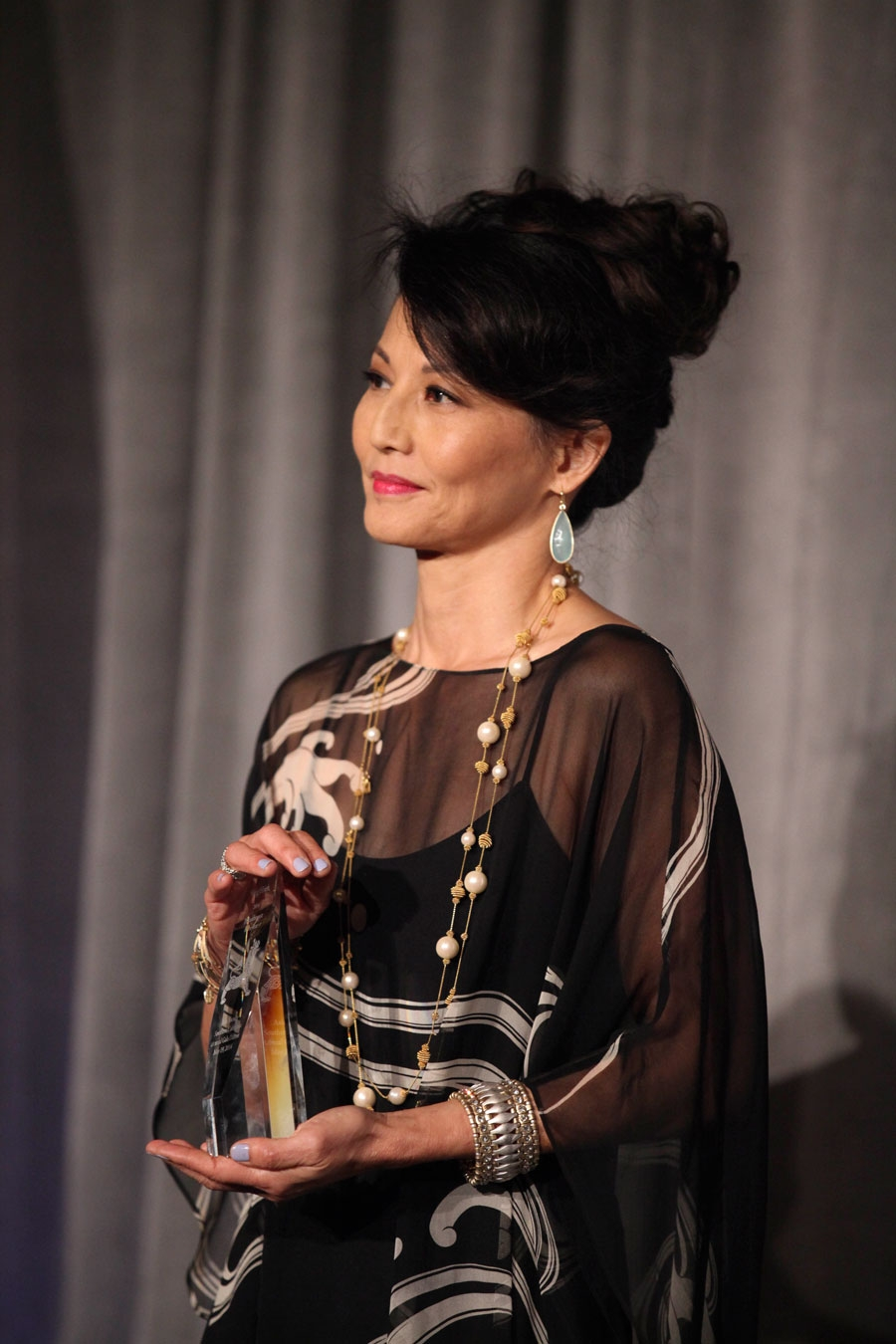 Emcee Tamlyn Tomita presents an award during the Asia Society Southern California 2014 Annual Gala held at the Millennium Biltmore Hotel on Monday, May 19, 2014, in Los Angeles, Calif. (Photo by Ryan Miller/Capture Imaging)