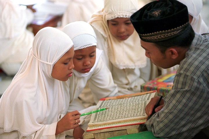 Young girls attend a class where they learn to read and memorize from the Koran in Banda Aceh, Aceh province of Indonesia. (Voja Miladinovic/Getty Images)
