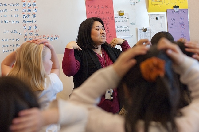 At Beacon Hill International School, a Mandarin Immersion teacher leads her class in a song, adding to the fun of learning Chinese language.