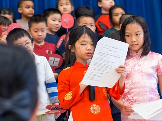 Mandarin Immersion students alternately speak in Chinese and English while moderating a Chinese New Year celebration and special assembly at Beacon Hill International School.