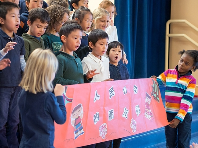 Beacon Hill International School Mandarin Immersion class welcomes students and guests from Renmin Primary School at a special assembly.