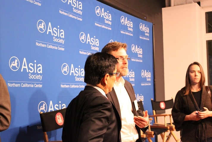 Birger Stamperdahl (center), President and CEO of Give2Asia, chats with an attendee after the event. (Asia Society)