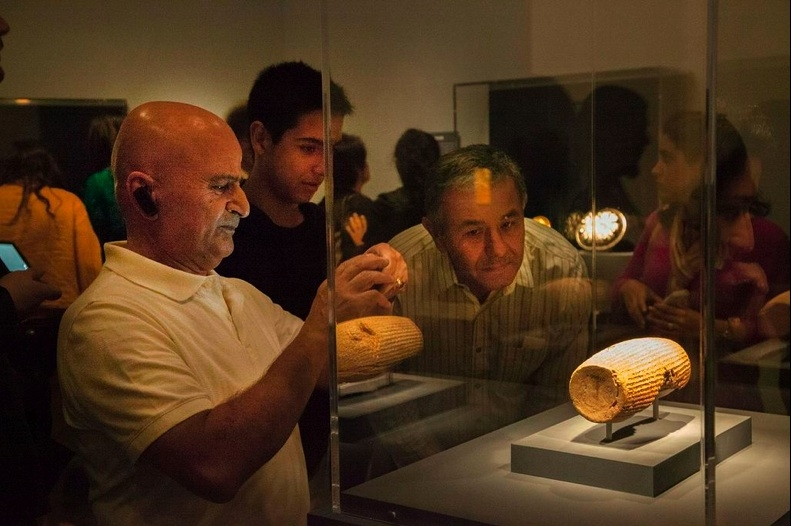 Guests view the Cyrus Cylinder in the new exhibition (Asian Art Museum San Francisco)