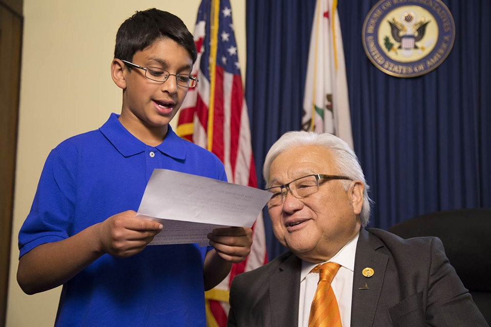 A Muslim American student reads a letter written by a World War II Japanese American internee to U.S. Representative (D-CA) Mike Honda, who was a resident of the Granada War Relocation Center, known as Camp Amache. (Photo courtesy of Frank Chi)