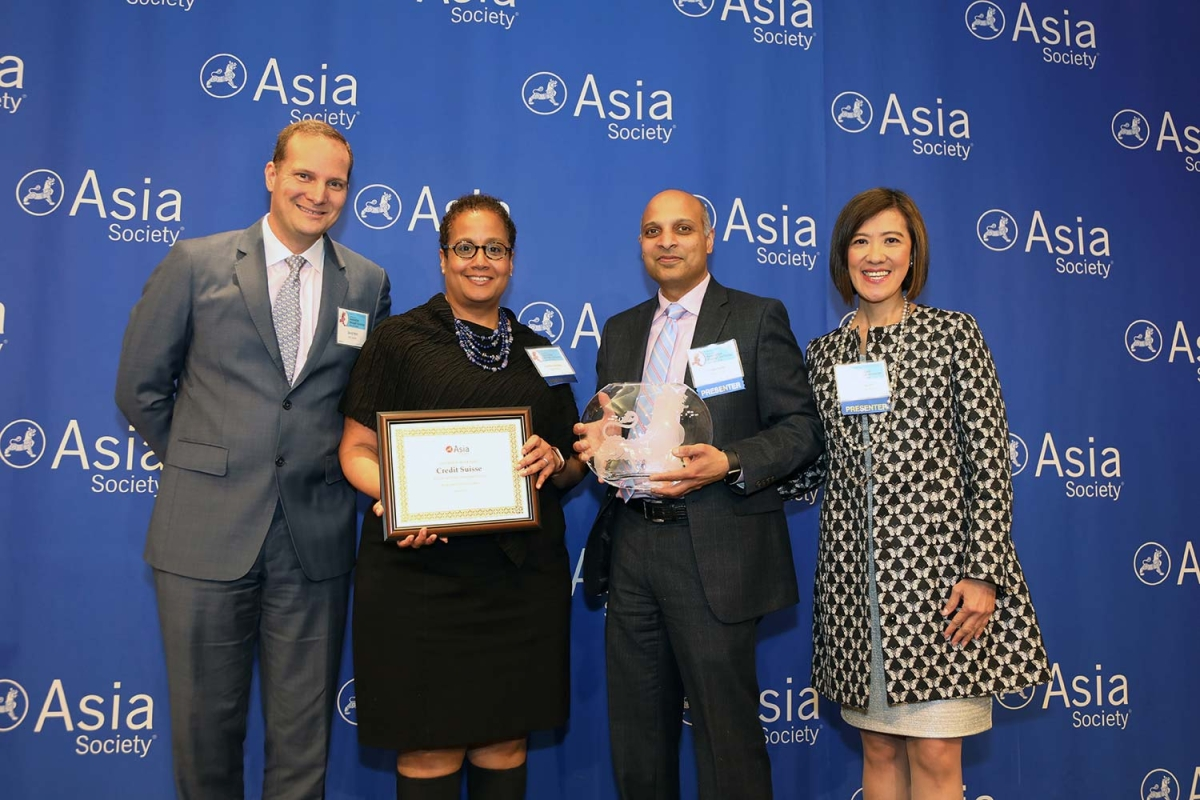 Pavan Ketty (R2) and Jennifer Andrews (L2) on behalf of Credit Suisse receive the award for Best Employer for Sponsorship of Asian Pacific Americans. (Ellen Wallop/Asia Society)