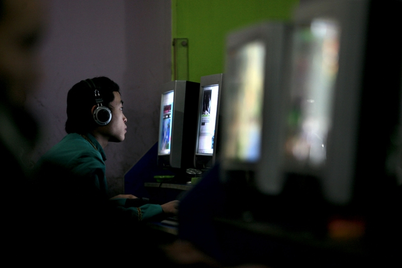 A Chinese youth uses a computer in an internet cafe in Chongqing, China. (China Photos/Getty Images)