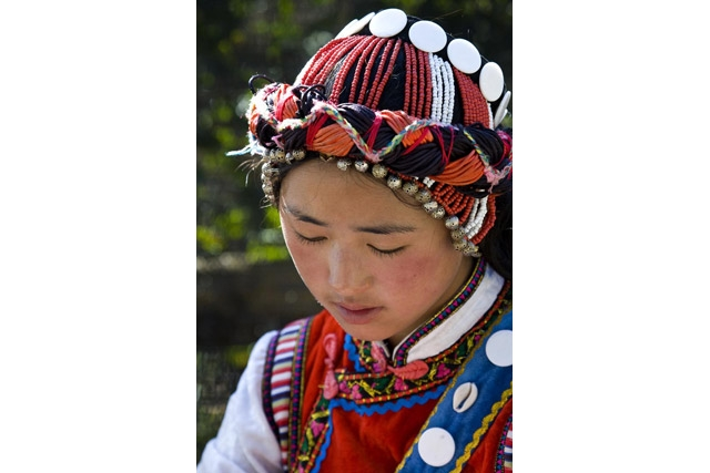 A girl in traditional clothing of a minority peoples in Kunming, China. (babasteve/flickr)