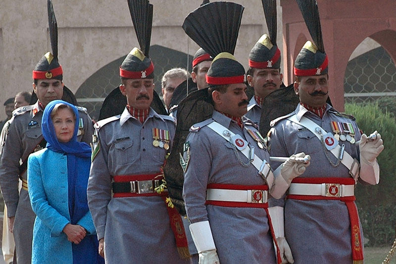US Secretary of State Hillary Clinton (2nd L in blue) is escorted by Pakistan Rangers as she arrives at the tomb of Pakistan's national poet Allama Mohammad Iqbal during her visit to Lahore on October 29, 2009. (STR/AFP/Getty Images)