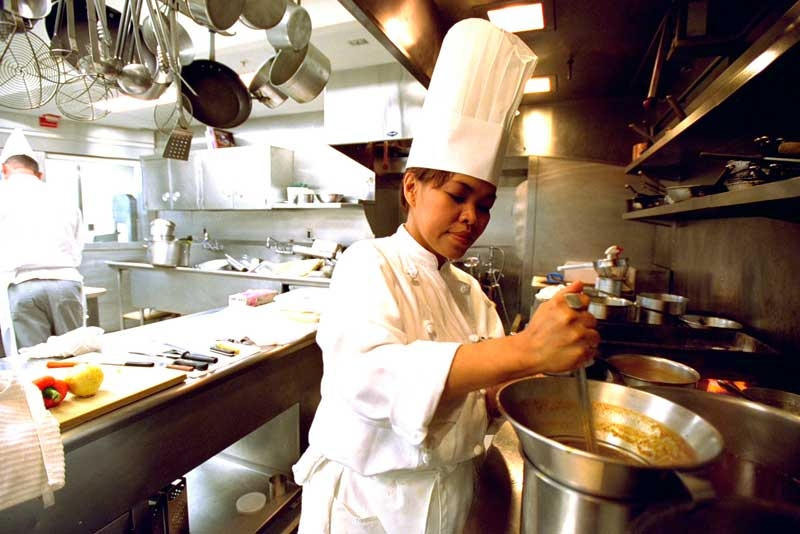 Chef Cristeta 'Cris' Comerford prepares a meal inside the White House kitchen July 17, 2002. In 2005, Comerford was named White House Executive Chef and the first woman to serve in the job. (Tina Hager/White House via Getty Images)