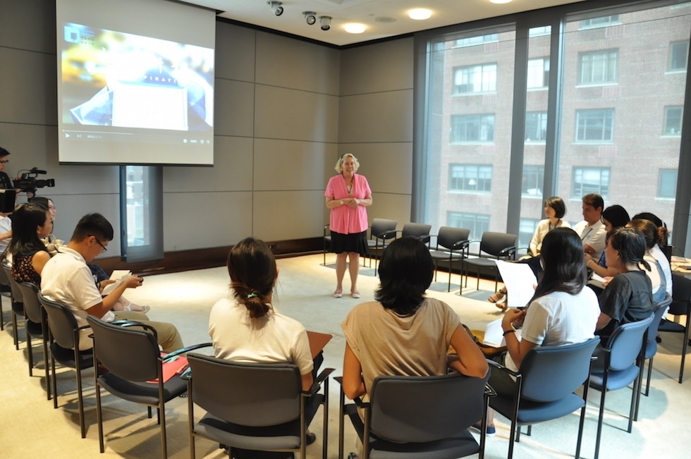 Asia Society Volunteer and Recruitment Manager Jacqueline Meyer (center) leads the orientation for the Young Scholars on their first day at Asia Society in New York. (Zhangbolong Liu & Zhu Xi/Asia Society)