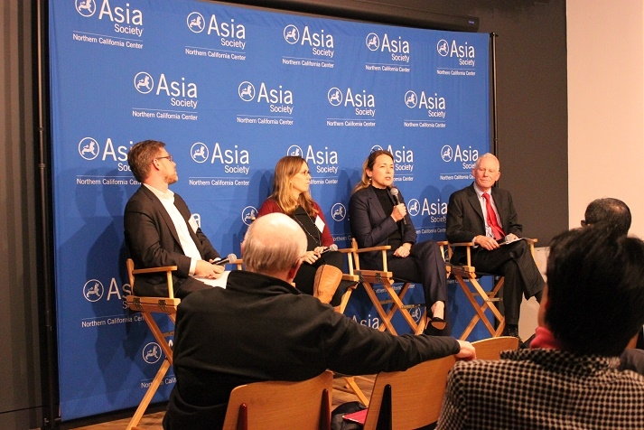 Dana Hyde (holding the mic), CEO of Millennium Challenge Corporation, started off the event. (Asia Society)