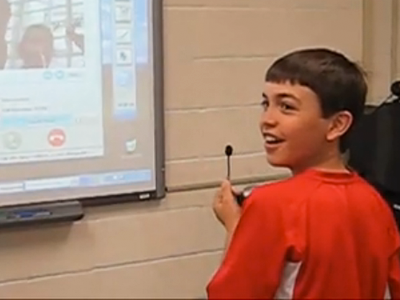 Student smiling in class (Herricks Middle School)