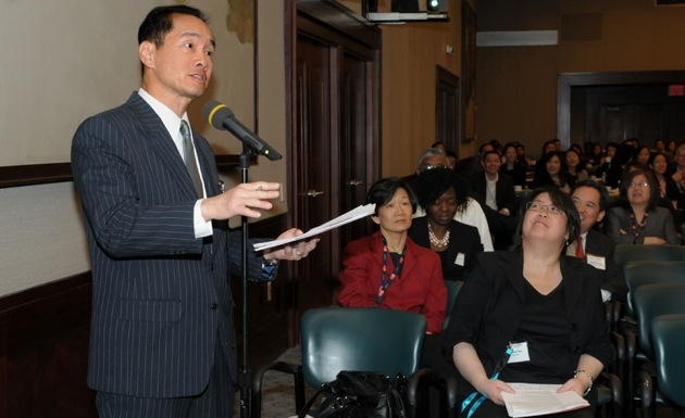 Fox News correspondent Ti-Hua Chang asks a question during the morning plenary.