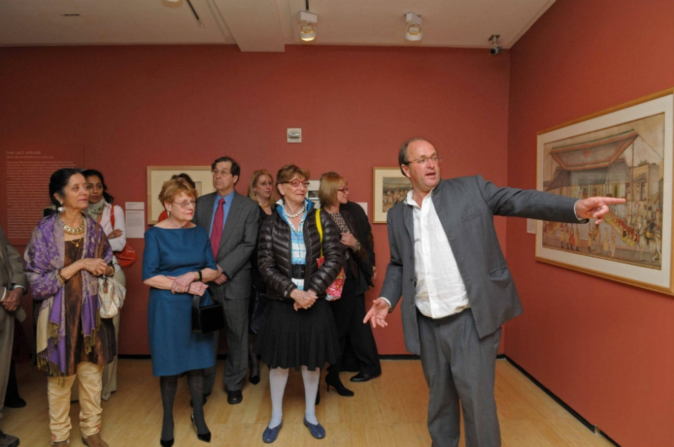 Historian William Dalrymple (R), co-curator of the exhibition, leads a tour for attendees. (Elsa Ruiz)