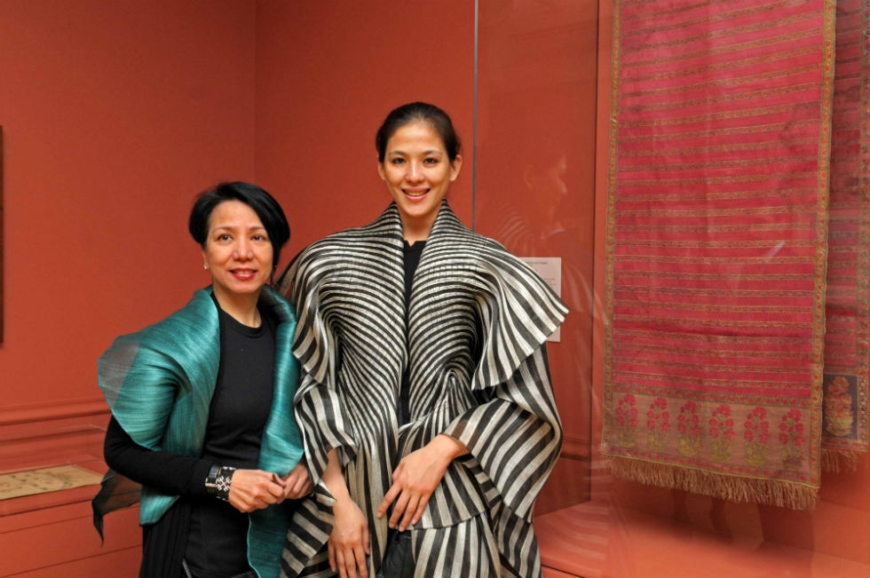 Designer Dita Sandico Ong (L) with a model wearing her signature banana fiber cape (exclusively at AsiaStore). (Elsa Ruiz)